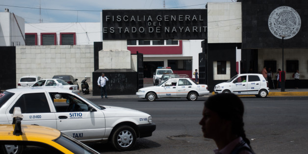 A pedestrian passes in front of the Nayarit State Attorney Generals headquarters in Tepic, Mexico, on Wednesday, March 29, 2017. On Wednesday, Nayarit Attorney General Edgar Veytia was arrested at the U.S. And Mexico border on drug trafficking charges filed by New York state on March 2. Photographer: Cesar Rodriguez/Bloomberg via Getty Images