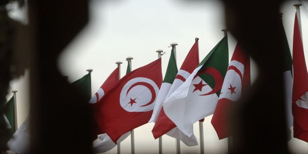 A general view shows Algerian and Tunisian flags during the welcome ceremony for the Tunisian president at the Houari Boumediene airport in Algiers on December 15, 2016.  / AFP / RYAD KRAMDI        (Photo credit should read RYAD KRAMDI/AFP/Getty Images)