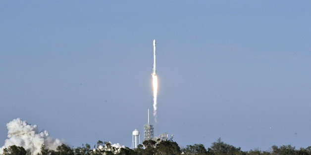 SpaceX's Falcon 9 rocket lifts off from space launch complex 39A at Kennedy Space Center, Florida on March 30, 2017, with an SES communications satellite.  SpaceX blasted off a recycled rocket for the first time on, using a booster that had previously flown cargo to the astronauts living at the International Space Station. / AFP PHOTO / BRUCE WEAVER        (Photo credit should read BRUCE WEAVER/AFP/Getty Images)