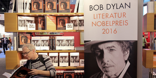 FRANKFURT AM MAIN, GERMANY - OCTOBER 19:  A man reads a book about Bob Dylan at the 2016 Frankfurt Book Fair (Frankfurter Buchmesse) on October 19, 2016 in Frankfurt am Main, Germany. The 2016 fair, which is among the world's largest book fairs, will be open to the public from October 19-23.  (Photo by Hannelore Foerster/Getty Images)