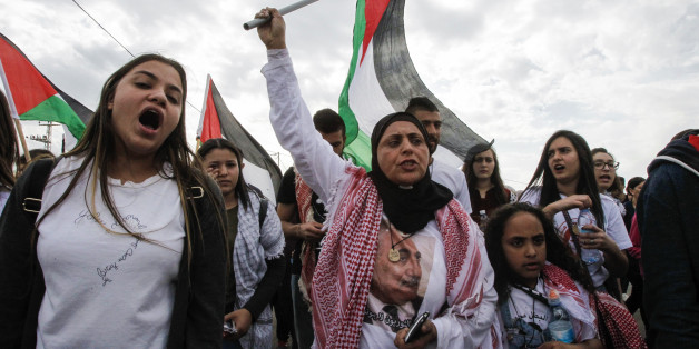 A female demonstrator waves a Palestinian flag during a demonstration marking Land Day on March 30, 2017 in the northern Arab-Israeli village of Deir Hanna in the northern Galilee region.Land Day marks the killing of six Arab Israelis during 1976 demonstrations against Israeli confiscations of Arab land. / AFP PHOTO / HAZEM BADER        (Photo credit should read HAZEM BADER/AFP/Getty Images)