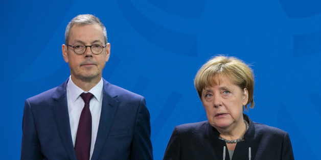 Angela Merkel, Germany's chancellor, center, speaks as Peter Bofinger, economist and member of the German council of economic advisers, left, and Christoph Schmidt, chairman of the German council of economic advisers, look on as the German government's council of economic advisers delivers its report at the Chancellery in Berlin, Germany, on Wednesday, Nov. 2, 2016. The European Union's balance of power will shift against its more market-oriented members if the U.K. drops out, the German government's council of economic advisers said, calling for 'constructive negotiations' to keep Britain in the EU despite the Brexit referendum. Photographer: Krisztian Bocsi/Bloomberg via Getty Images