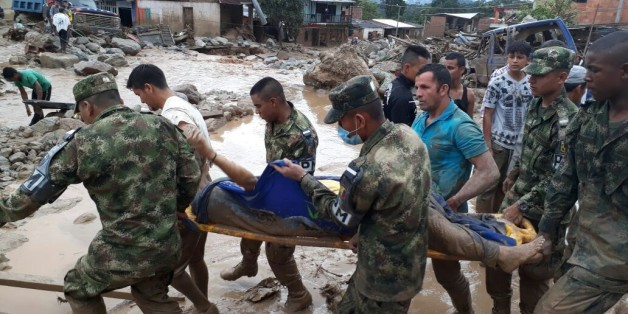 MOCOA, COLOMBIA - APRIL 01: (----EDITORIAL USE ONLY  MANDATORY CREDIT - 'COLOMBIAN ARMED FORCES 6TH ARMY  / HANDOUT' - NO MARKETING NO ADVERTISING CAMPAIGNS - DISTRIBUTED AS A SERVICE TO CLIENTS----)   Colombian soldiers evacuate the victims of a deadly avalanche that happened following heavy rains in Macoa, Putumayo Colombia on April 01, 2017.  At least 154 people lost their lives after three rivers in southern Colombia burst their banks early Saturday, creating an avalanche of mud and rocks th