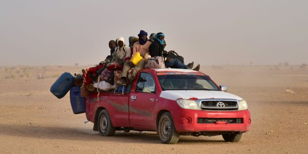 West African people coming back to Niger after fleeing Libya due to armed groups, arrive on a pick up in Agadez, northern Niger, on March 31, 2017, following their failed attempt to reach Europe by crossing the Mediterranean sea. / AFP PHOTO / ISSOUF SANOGO        (Photo credit should read ISSOUF SANOGO/AFP/Getty Images)