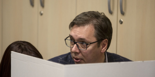 Presidential candidate and Serbian Prime Minister Aleksandar Vucic (C) casts his ballot at a polling station in Belgrade on April 2, 2017.Serbians head to the polls to elect a new president, with strongman Aleksandar Vucic hoping to tighten his grip on power amid opposition accusations he is shifting the country to authoritarian rule. / AFP PHOTO / OLIVER BUNIC        (Photo credit should read OLIVER BUNIC/AFP/Getty Images)