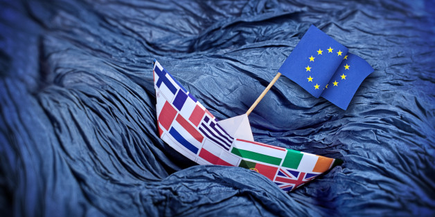 The EU paper boat over troubled water. Waves made of blue wrinkled fabric.