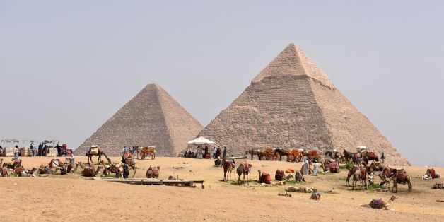 Egyptian camel owners wait for tourists outside the pyramids, on the Giza Plateau, on the southern outskirts of the capital Cairo on March 29, 2017. / AFP PHOTO / MOHAMED EL-SHAHED        (Photo credit should read MOHAMED EL-SHAHED/AFP/Getty Images)