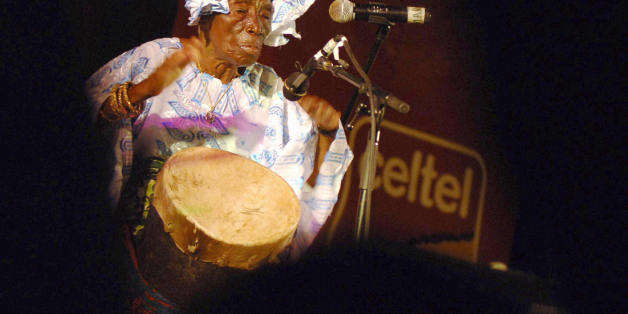 Zanzibar, TANZANIA, UNITED REPUBLIC OF:  Zanzibari legend singer Bi Kidude bint Baraka, in her nineties, performs at the third Sauti za Busara Music Festival, 11 February 2006 in Zanzibar. Starting back in the 1920s, Bi Kidudue is the Island's leading exponent of the ancient ritual dance, performed exclusively for teenage girls, which use traditional rythym to teach women to please their husbands, while lecturing against the dangers of sexual abuse and oppression. Late 2005, Bi Kidude was awarde