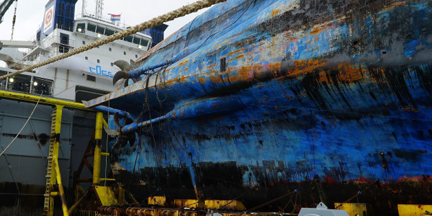 MOKPO, SOUTH KOREA - APRIL 1: In this handout photo released by the South Korean Ministry of Oceans and Fisheries, The sunken ferry Sewol sitting on a semi-submersible transport vessel arrived at a port in Mokpo on April 1, 2017 in Mokpo, South Korea. The Sewol sank off the Jindo Island in April 2014 leaving more than 300 people dead and nine of them still remain missing. (Photo by South Korean Ministry of Oceans and Fisheries via Getty Images)