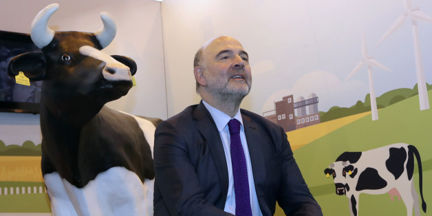 European Commissioner for Economic and Financial Affairs, Pierre Moscovici sits at the European Commission stand at the Agriculture Fair in Paris on February 27, 2017.  / AFP / Jacques DEMARTHON        (Photo credit should read JACQUES DEMARTHON/AFP/Getty Images)