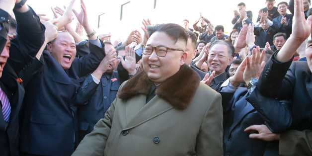 This undated picture released from North Korea's official Korean Central News Agency (KCNA) on March 11, 2017 shows North Korean leader Kim Jong-Un (C) visiting the remodeled Paektusan Institute of Architecture in Pyongyang. NTS / AFP PHOTO / KCNA / KNS        (Photo credit should read KNS/AFP/Getty Images)