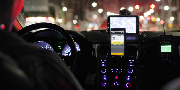 A smartphone showing the Kakao Taxi app, developed by Daum Kako Corp., sits mounted on the dashboard of a taxi in Seoul, South Korea, on Friday, July 17, 2015. A report on July 23 may show that South Korea's economy expanded 2.3 percent in the second quarter, which would be the slowest pace in more than two years, according to the median estimate in a Bloomberg survey. Photographer: Woohae Cho/Bloomberg via Getty Images