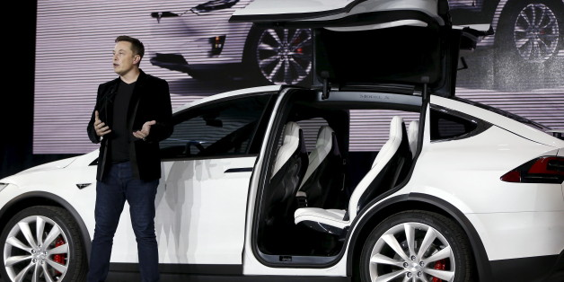 Tesla Motors CEO Elon Musk introduces the falcon wing door on the Model X electric sports-utility vehicles during a presentation in Fremont, California, U.S. September 29, 2015.  REUTERS/Stephen Lam/File Photo