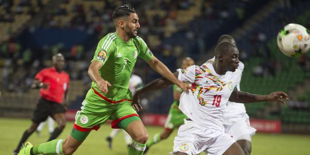 FRANCEVILLE, GABON - JANUARY 23: RIYAD KARIM MAHREZ of Algeria and SALIOU CISS of Senegal during the Group B match between Senegal and Algeria at Stade Franceville on January 23, 2017 in Franceville, Gabon. (Photo by Visionhaus/Corbis via Getty Images)