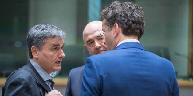 Euclid Tsakalotos, Greece's finance minister, left, speaks with Pierre Moscovici, economic commissioner for the European Union (EU), center, and Jeroen Dijsselbloem, Dutch finance minister and head of the group of euro-area finance ministers, ahead of a Eurogroup meeting of finance ministers in Brussels, Belgium, on Monday, March 20, 2017. Wolfgang Schaeuble, Germany's finance minister, said to reporters ahead of the meeting of euro-area finance ministers Well get a report on Greece, but the mission isnt completed,. Photographer: Jasper Juinen/Bloomberg via Getty Images
