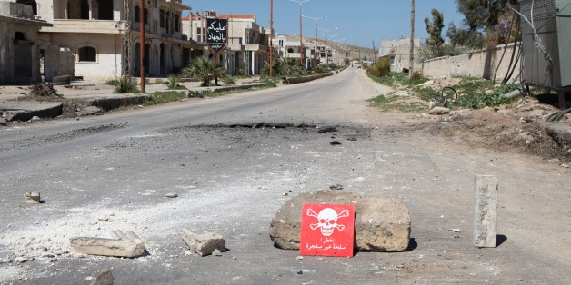 IDLIB, SYRIA - APRIL 05: A poison hazard danger sign is seen in the town of Khan Shaykun, Idlib province, Syria on April 05, 2017. On Tuesday more than 100 civilians had been killed and 500 others, mostly children, injured in Assad Regime's suspected chlorine gas attack carried out by warplanes in the town of Khan Shaykun, Idlib province. (Photo by Abdussamed Dagul/Anadolu Agency/Getty Images)