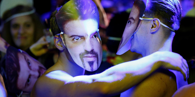 Dancers wear George Michael masks at a tribute night event in his honour, in London, Britain, January 6, 2017. REUTERS/Peter Nicholls