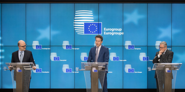 Pierre Moscovici, economic commissioner for the European Union (EU), from left, Jeroen Dijsselbloem, Dutch finance minister and head of the group of euro-area finance ministers, and Klaus Regling, managing director of the European Stability Mechanism, participate in a news conference following a Eurogroup meeting of finance ministers in Brussels, Belgium, on Monday, March 20, 2017. Wolfgang Schaeuble, Germany's finance minister, said to reporters ahead of the meeting of euro-area finance ministe