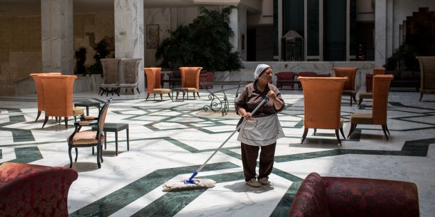 SOUSSE, TUNISIA - JUNE 24:  An employee mops the lobby floor at the closed Imperial Marhaba Hotel on June 24, 2016 in Sousse, Tunisia. The Imperial Marhaba hotel was the main target of the 2015 Sousse beach terrorist attack that killed 38 people including 30 Britons. The hotel attempted to stay open for three months after the attacks, however low occupancy forced the hotel to close. Since then it has operated with a skeleton staff, who work to maintain the rooms and grounds, other permanent hote