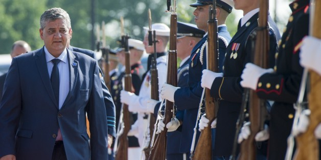Belgium's Defense Minister Steven Vandeput walks past an honor guard as he arrives to attend a meeting of defense ministers of the Global Coalition to Counter ISIL at Joint Base Andrews in Maryland, July 20, 2016. / AFP / SAUL LOEB        (Photo credit should read SAUL LOEB/AFP/Getty Images)