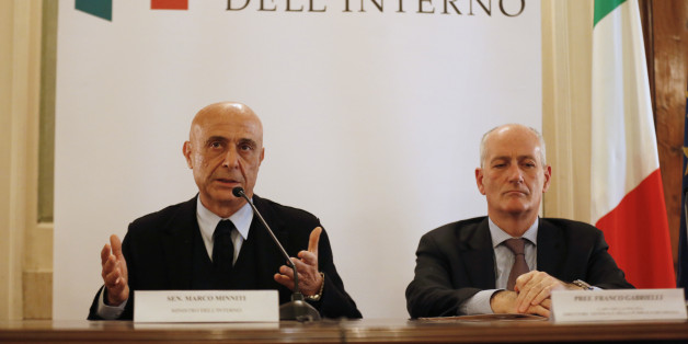 Italian Interior Minister Marco Minniti (L) and cheif of police Franco Gabrielli attend a news conference in Rome, Italy, to announce that the suspect in the Berlin truck attack was killed in a shoot-out in a suburb of the norhtern Italian city of Milan, December 23, 2016.    REUTERS/Alessandro Bianchi