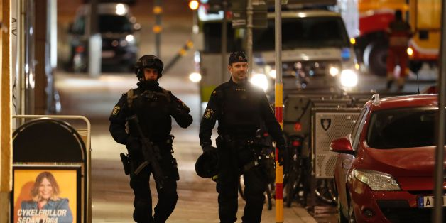 Swedish police officers patrol on April 8, 2017, the area where a stolen truck was driven through a crowd outside a department in Stockholm on April 7, 2017. A massive manhunt was underway for the driver of the stolen truck that ploughed into the crowd, killing four and injuring 15, Swedish police said. / AFP PHOTO / Odd ANDERSEN        (Photo credit should read ODD ANDERSEN/AFP/Getty Images)