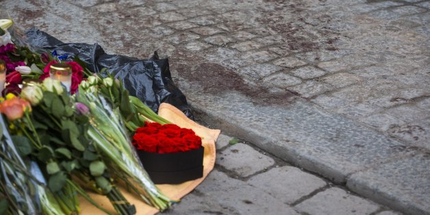 STOCKHOLM, SWEDEN - APRIL 08:  Dried blood remains on the pavement on Drottninggatan at the scene of the terrorist truck attack in downtown of the city where sympathy flowers are being left on April 8, 2017 in Stockholm, Sweden. The attack where a hijacked truck crashed into the front of Ahlens department store killed four people and injured another 15.  (Photo by Michael Campanella/Getty Images)