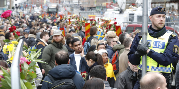 People gather at a makeshift memorial near the scene where a truck slammed the day before into a crowd of people outside a busy department store in central Stockholm, on April 8, 2017.  / AFP PHOTO / Odd ANDERSEN        (Photo credit should read ODD ANDERSEN/AFP/Getty Images)