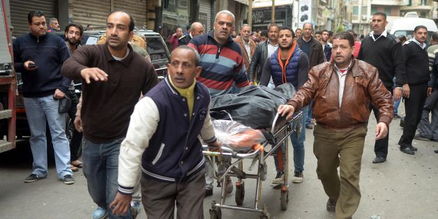 Egyptians wheel away a body near a church in Alexandria after a bomb blast struck worshippers gathering to celebrate Palm Sunday on April 9, 2017.The Interior ministry said Coptic Pope Tawadros II was inside the church leading a Palm Sunday service when the suicide bomber was stopped by police outside and blew himself up.A church official said Tawadros had already left the church when the bombing took place. / AFP PHOTO / STRINGER        (Photo credit should read STRINGER/AFP/Getty Images)