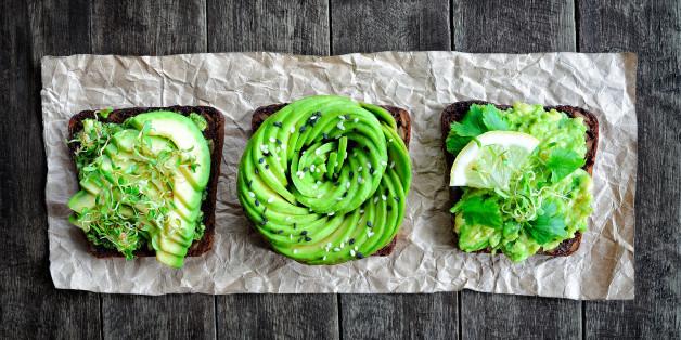 Fresh avocado toasts with alfalfa sprouts & cilantro