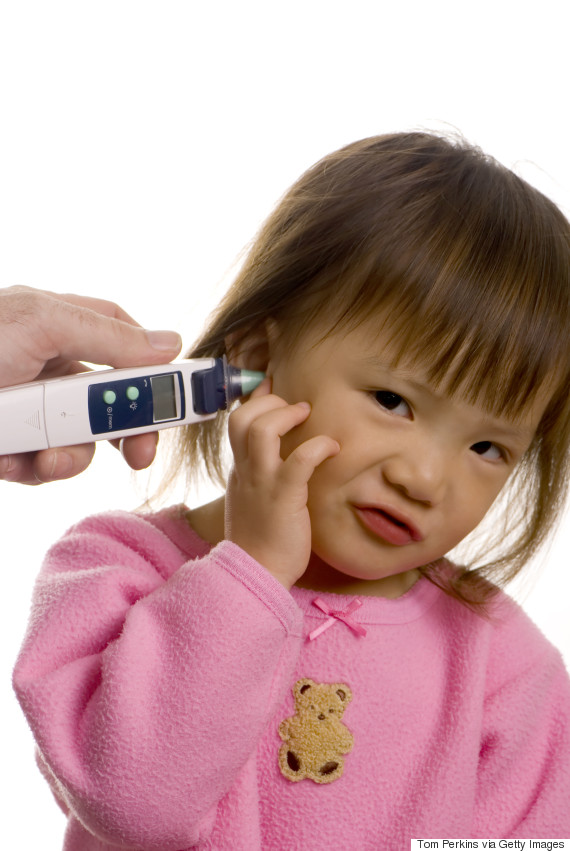 toddler holding ear