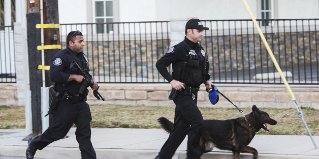 Shooting in San Bernardino. San Bernardino Police Department officers searching for more possible shooters after two shooters just engaged them to the north. (Photo by Ted Soqui/Corbis via Getty Images)