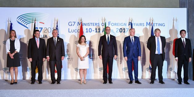 From left : EU High Representative for Foreign Affairs and Security Policy Federica Mogherini, German Foreign Minister Sigmar Gabriel, US Secretary of State Rex Tillerson, Canadian Foreign Minister Chrystia Freeland, Italy Foreign Minister Angelino Alfano, French Foreign Minister Jean-Marc Ayrault, British Foreign Secretary Boris Johnson and Japanese Foreign Minister Fumio Kishida pose for a family picture on the second day of a meeting of Foreign Affairs Ministers from the Group of Seven (G7) industrialised countries on April 11, 2017 in Lucca, Tuscany.   / AFP PHOTO / Vincenzo PINTO        (Photo credit should read VINCENZO PINTO/AFP/Getty Images)