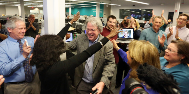 The Miami Herald newsroom reacts to the second of two Pulitzer Prize awards announced on Monday, April 10, 2017. Nancy Ancrum, editorial page editor, reaches to give Jim Morin, political cartoonist, a hug for his second career Pulitzer. (Emily Michot/Miami Herald/TNS via Getty Images)
