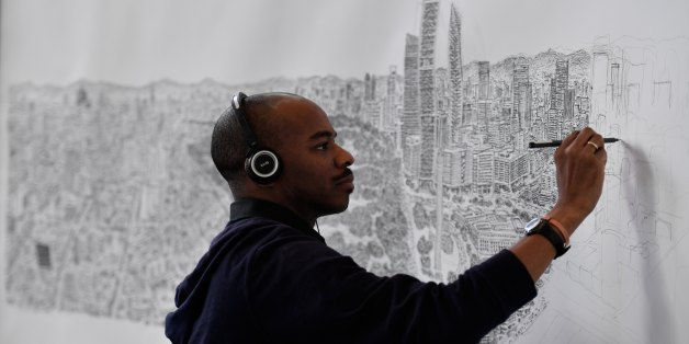 British artist Stephen Wiltshire draws freehand a panoramic view of Mexico City, in the Mexican capital, on October 26, 2016.Wiltshire is an artist who draws and paints cityscapes around the world in great detail. / AFP / Yuri CORTEZ        (Photo credit should read YURI CORTEZ/AFP/Getty Images)