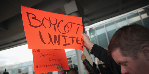 CHICAGO, IL - APRIL 11:  Demonstrators protest outside the United Airlines terminal at O'Hare International Airport on April 11, 2017 in Chicago, Illinois. United Airlines has been struggling to restore their corporate image after a cell phone video was released showing a passenger being dragged from his seat and bloodied by airport police after he refused to leave a reportedly overbooked flight.  (Photo by Scott Olson/Getty Images)
