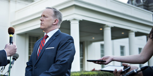 White House Press Secretary Sean Spicer speaks to a reporter about a comparison he made between Syria's President Bashar al-Assad and Hitler during an earlier press briefing at the White House April 11, 2017 in Washington, DC.Spicer apologized Tuesday for 'insensitive' remarks during a press briefing in which he asserted that Adolf Hitler did not use chemical weapons on his own people. / AFP PHOTO / Brendan Smialowski        (Photo credit should read BRENDAN SMIALOWSKI/AFP/Getty Images)