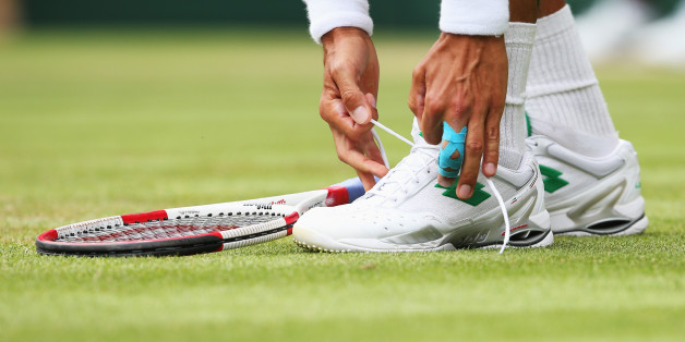 LONDON, ENGLAND - JUNE 26: a detail shot of Lukas Rosol of Czech Republic tying his shoelace during his Gentlemen's Singles second round match against Rafael Nadal of Spain on day four of the Wimbledon Lawn Tennis Championships at the All England Lawn Tennis and Croquet Club at Wimbledon on June 26, 2014 in London, England.  (Photo by Jan Kruger/Getty Images)