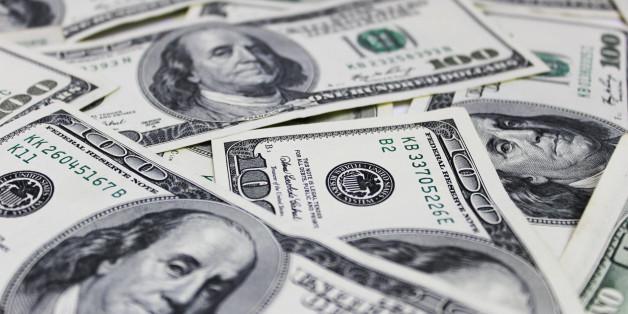 Hundred dollar bills money pile background