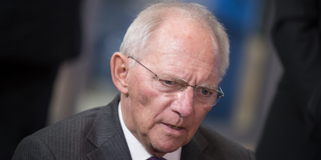 Wolfgang Schaeuble, Germany's finance minister, speaks to reporters as he arrives for a Eurogroup meeting of finance ministers in Brussels, Belgium, on Monday, March 20, 2017. Wolfgang Schaeuble, Germany's finance minister, said to reporters ahead of the meeting of euro-area finance ministers Well get a report on Greece, but the mission isnt completed,. Photographer: Jasper Juinen/Bloomberg via Getty Images