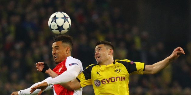 Football Soccer - Borussia Dortmund v AS Monaco - UEFA Champions League Quarter Final First Leg - Signal Iduna Park, Dortmund, Germany - 12/4/17 Borussia Dortmund's Raphael Guerreiro in action with Monaco's Nabil Dirar  Reuters / Kai Pfaffenbach Livepic