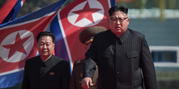 North Korean leader Kim Jong-Un (R) arrives flanked by vice-chairman of the State Affairs Commission Choe Yong-Hae (L) at an opening ceremony for 'Rymoyong street', a new housing development in Pyongyang, on April 13, 2017.With thousands of adoring North Koreans looking on -- along with invited international media -- Kim Jong-Un opened a prestige housing project as he seeks to burnish his nation's image even as concerns over its nuclear capabilities soar. / AFP PHOTO / ED JONES        (Photo cre