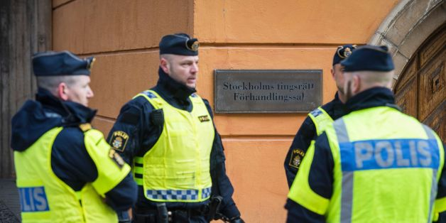 Policemen secure the entrance to the Stockholm District Court where Uzbek national Rakhmat Akilov (not in picture), prime suspect in the Stockholm truck attack, appeared in court on April 11, 2017. 39-year-old Uzbek national Akilov suspected of mowing down a crowd of people on a busy Stockholm street in a stolen truck admitted committing 'a terrorist crime,' his lawyer said. / AFP PHOTO / Jonathan NACKSTRAND        (Photo credit should read JONATHAN NACKSTRAND/AFP/Getty Images)