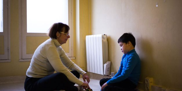 An assistant takes care of Jules, a 8-year-old autistic boy, on March 24, 2017 in Courbevoie, north-west of Paris, at the Lud'Eveil center for children with autism, which uses the '3i' developmental method, based on games . The ninth annual World Autism Awareness Day will be marked on April 2, 2017. / AFP PHOTO / MARTIN BUREAU        (Photo credit should read MARTIN BUREAU/AFP/Getty Images)