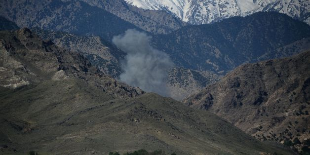 Smoke rises after an air strike on Islamic State (IS) militants positions during an ongoing operation against the group in the Achin district of Afghanistan's Nangarhar province on April 14, 2017, a day after the US military struck the district with its largest non-nuclear bomb.The US military's largest non-nuclear bomb killed dozens of Islamic State militants as it smashed their mountain hideouts, Afghan officials said April 14, ruling out any civilian casualties despite the weapon's destructiv