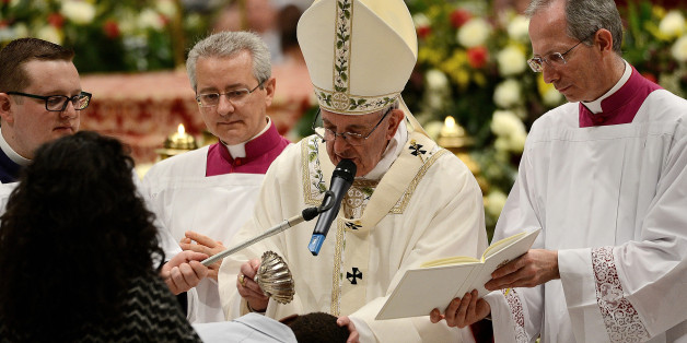 S PETER, VATICAN, LAZIO - 2017/04/15: Pope Francis in St. Peter's Basilica, celebrated the vigil that precedes Easter. The ritual began in the atrium of the basilica with the blessing of fire and preparation of the paschal candle. After the procession and liturgy, the Pope gave to the sacraments of Baptism, Confirmation and First Communion at 11 newcomers from different parts of the world. (Photo by Andrea Franceschini/Pacific Press/LightRocket via Getty Images)