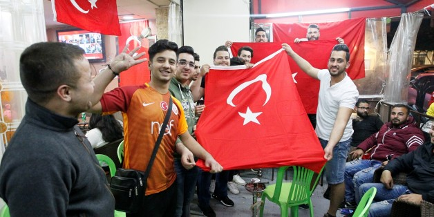 BEIRUT, LEBANON - APRIL 16: Yes' supporters celebrate their victory following the unofficial preliminary results of Turkeys constitutional referendum show 'Yes' votes ahead of 'No' votes, in Beirut, Lebanon on April 16, 2017. Turkish people voted on the proposed change to a presidential system to replace the parliamentary democracy, with 18 articles proposed to be amended in the constitution.