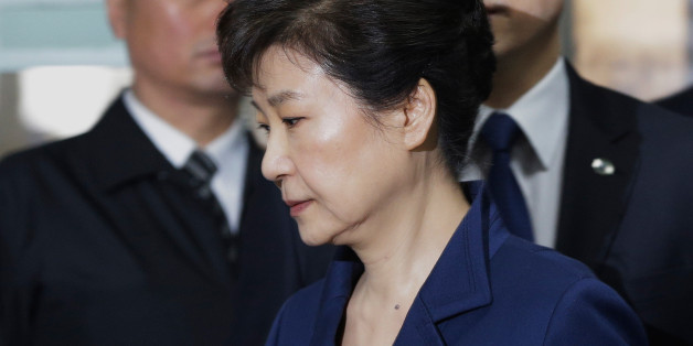 South Korea's ousted president Park Geun-Hye (front) arrives for questioning on her arrest warrant at the Seoul Central District Court in Seoul on March 30, 2017.Park arrived at court on March 30 for a hearing to decide whether she should be arrested over the corruption and abuse of power scandal that brought her down. / AFP PHOTO / POOL / Ahn Young-joon        (Photo credit should read AHN YOUNG-JOON/AFP/Getty Images)