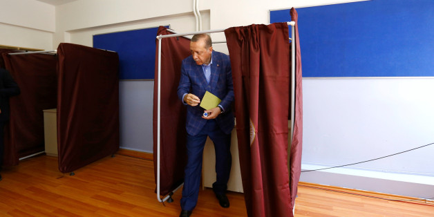 Turkish President Tayyip Erdogan leaves a voting booth at a polling station during a referendum in Istanbul, Turkey, April 16, 2017. REUTERS/Murad Sezer     TPX IMAGES OF THE DAY