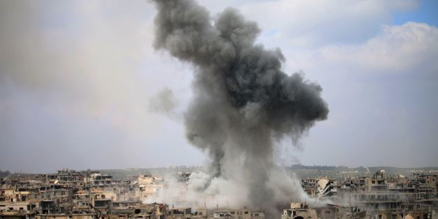 Smoke billows following a reported air strike on a rebel-held area in the southern Syrian city of Daraa, on April 16, 2017. / AFP PHOTO / Mohamad ABAZEED        (Photo credit should read MOHAMAD ABAZEED/AFP/Getty Images)